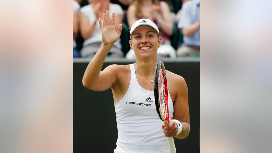 Angelique Kerber of Germany celebrates after beating Misaki Doi of Japan in their women's singles match on day eight of the Wimbledon Tennis Championships in London, Monday, July 4, 2016. (AP Photo/Ben Curtis)