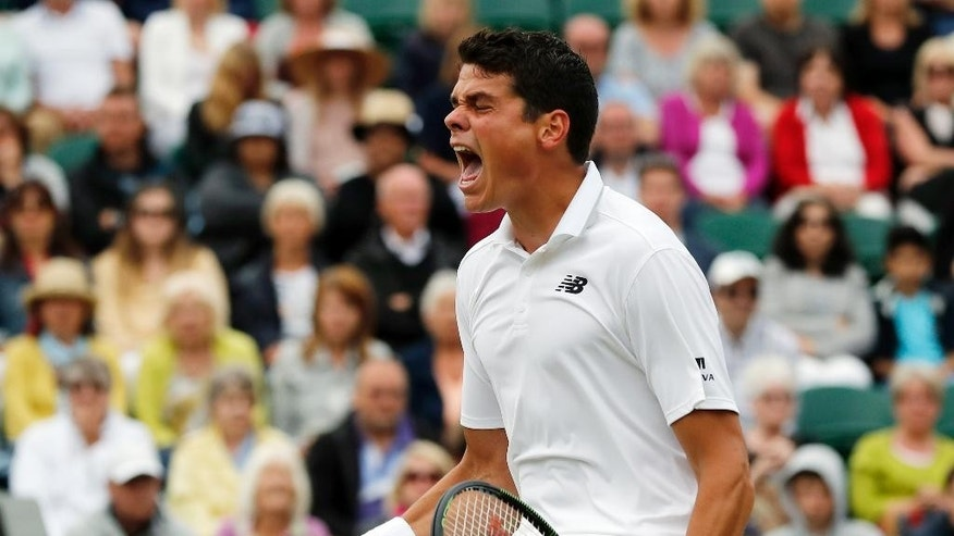 Milos Raonic of Canada celebrates a point against David Goffin of Belgium during their men's singles match on day eight of the Wimbledon Tennis Championships in London, Monday, July 4, 2016. (AP Photo/Ben Curtis)