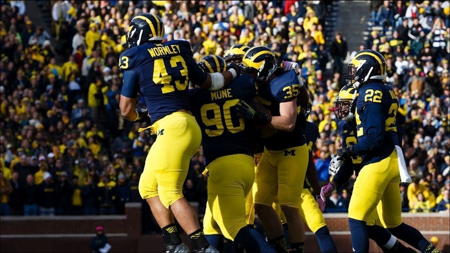 <p>Nov 1, 2014; Ann Arbor, MI, USA; Michigan Wolverines defensive lineman Chris Wormley (43) defensive tackle Bryan Mone (90) linebacker Joe Bolden (35) safety Jarrod Wilson (22) and linebacker Jake Ryan (47) celebrate against the Indiana Hoosiers at Michigan Stadium. Mandatory Credit: Rick Osentoski-USA TODAY Sports</p>
