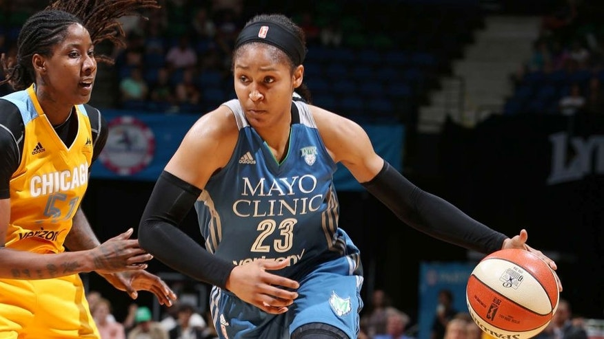 MINNEAPOLIS, MN - JULY 5: Maya Moore #23 of the Minnesota Lynx drives to the basket against Jessica Breland #51 of the Chicago Sky on July 5, 2016 at Target Center in Minneapolis, Minnesota. NOTE TO USER: User expressly acknowledges and agrees that, by downloading and or using this Photograph, user is consenting to the terms and conditions of the Getty Images License Agreement. Mandatory Copyright Notice: Copyright 2016 NBAE (Photo by David Sherman/NBAE via Getty Images)