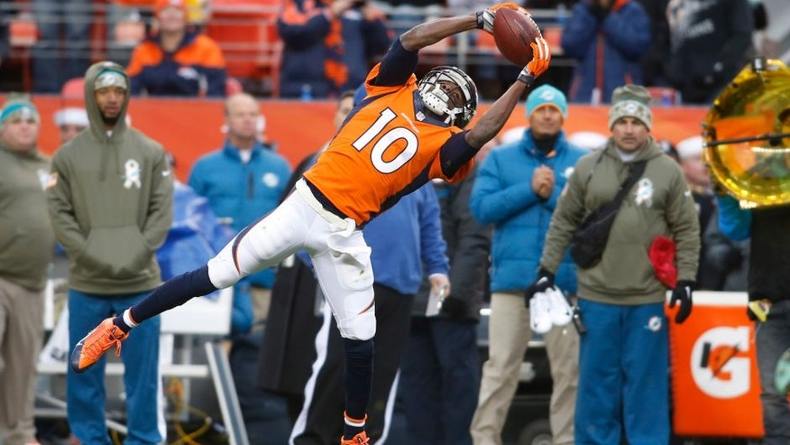 Nov 23, 2014; Denver, CO, USA; Denver Broncos wide receiver Emmanuel Sanders (10) catches a pass during the first half against the Miami Dolphins at Sports Authority Field at Mile High. Mandatory Credit: Chris Humphreys-USA TODAY Sports