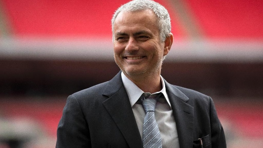 FILE- In this Monday, Feb. 1, 2016 file photo, former Chelsea manager Jose Mourinho smiles as he attends an event at Wembley Stadium in London.  Now manager of Manchester United,  Mourinho says the club is in need of both a quick-fix and long-term stability, as the 53-year-old enigmatic Portuguese was presented to the media for the first time Tuesday July 5, 2016.  (AP Photo/Matt Dunham, FILE)