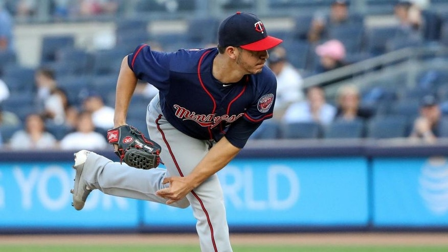 Jun 24, 2016; Bronx, NY, USA; Minnesota Twins starting pitcher Tommy Milone (33) pitches during the first inning against the New York Yankees at Yankee Stadium. Mandatory Credit: Anthony Gruppuso-USA TODAY Sports