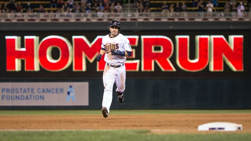 Jun 22, 2015; Minneapolis, MN, USA; Minnesota Twins second baseman Brian Dozier rounds second base after hitting a home run in the eighth inning against the Chicago White Sox at Target Field.