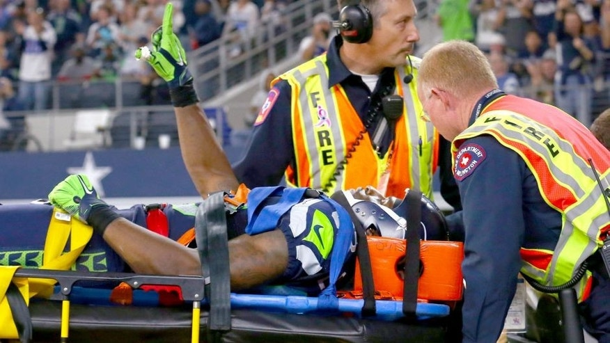 ARLINGTON, TX - NOVEMBER 01: Ricardo Lockette #83 of the Seattle Seahawks waves to fans while being carted off the field in the second quarter at AT&T Stadium on November 1, 2015 in Arlington, Texas. (Photo by Tom Pennington/Getty Images)