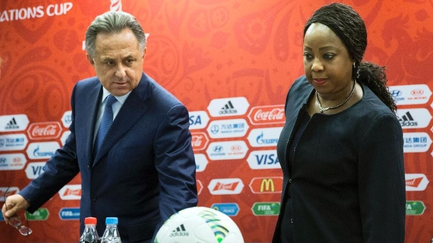 Russian Sports Minister Vitaly Mutko, left, and FIFA Secretary General Fatma Samoura arrive for a news conference in Moscow, Russia, Tuesday, July 5, 2016. FIFA has revealed the ticket prices for the 2018 World Cup, with the cost of the cheapest tickets for foreign fans up more than 16 percent since 2014. (AP Photo/Pavel Golovkin)