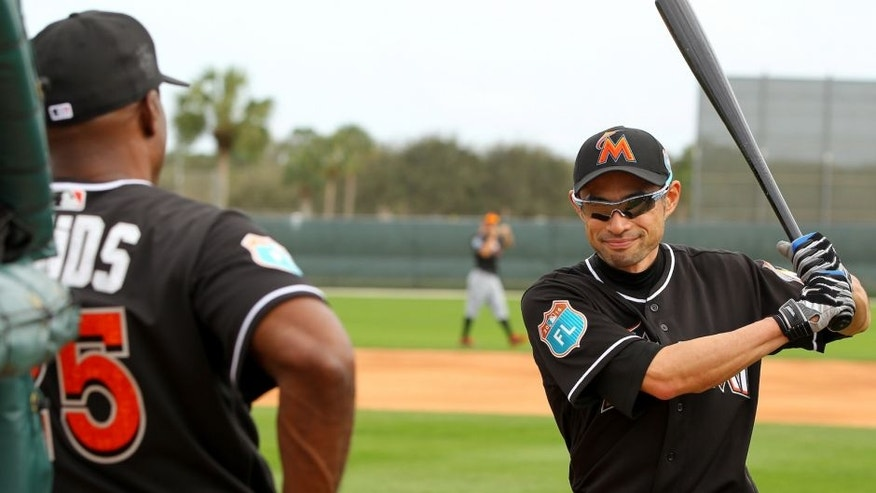 JUPITER, FL - FEBRUARY 23: Ichiro Suzuki #51 talks with new Marlins hitting coach Barry Bonds #25 during a Miami Marlins workout on February 23, 2016 in Jupiter, Florida. (Photo by Rob Foldy/Getty Images)