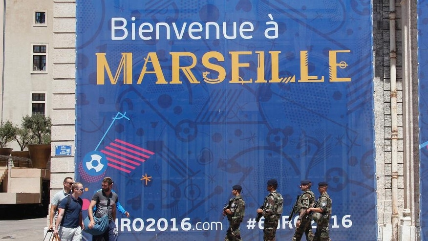 French soldiers on patrol in downtown Marseille, southern France, a day before the world champion takes on the host nation in the European Championship's second semifinal , Wednesday, July 6, 2016. France will face Germany in a Euro 2016 semifinal soccer match in Marseille on Thursday, July 7, 2016. (AP Photo/Claude Paris)