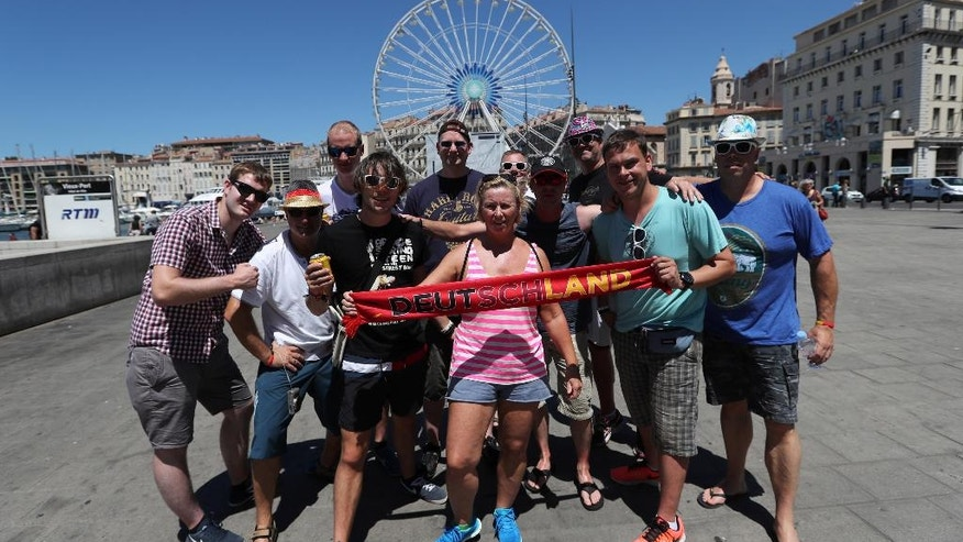 German soccer fans pose for photographers in downtown Marseille, southern France, a day before the world champion takes on the host nation in the European Championship's second semifinal , Wednesday, July 6, 2016. France will face Germany in a Euro 2016 semifinal soccer match in Marseille on Thursday, July 7, 2016. (AP Photo/Claude Paris)