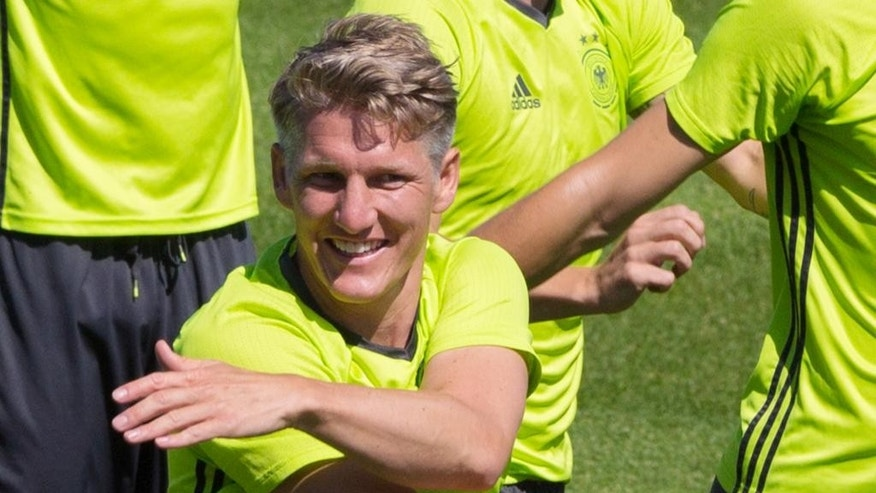 Bastian Schweinsteiger, center, attends the last training session of the German national football team at their base camp in Evian-Les-Bains, France, Wednesday, July 6, 2016. Germany will face France in a Euro 2016 semifinal soccer match in Marseille on Thursday, July 7, 2016 (AP Photo/Cirian Fahey)