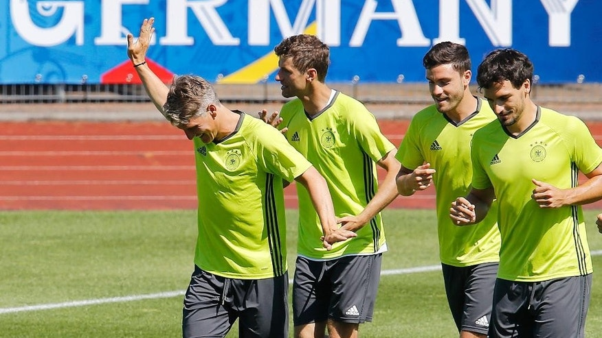 Bastian Schweinsteiger, Thomas Mueller, Jonas Hector and Mats Hummels, from left, run during the last training session of the German national football team at their base camp in Evian-Les-Bains, France, Wednesday, July 6, 2016. Germany will face France in a Euro 2016 semifinal soccer match in Marseille on Thursday, July 7, 2016 (AP Photo/Michael Probst)