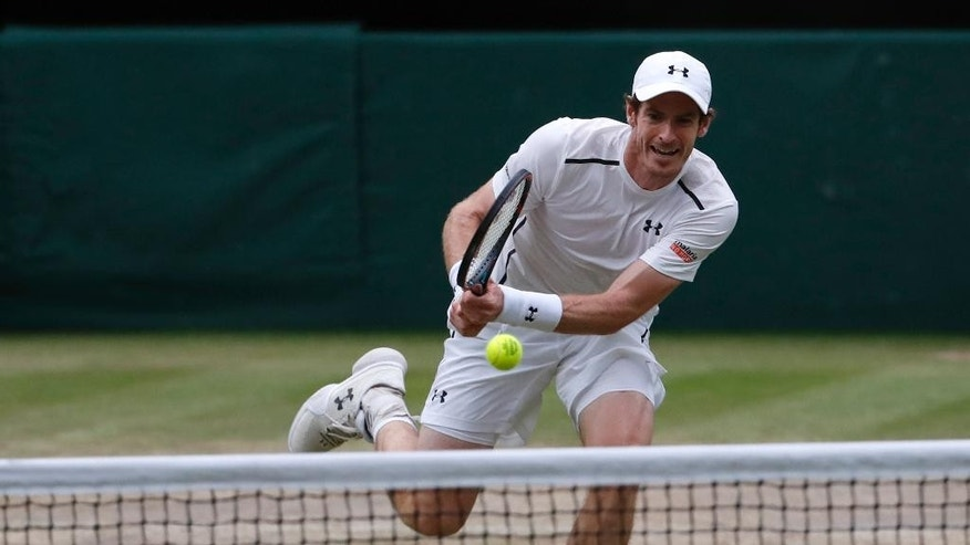 Andy Murray of Britain plays a return to Jo-Wilfried Tsonga of France during their men's singles quarterfinal match on day ten of the Wimbledon Tennis Championships in London, Wednesday, July 6, 2016. (AP Photo/Ben Curtis)