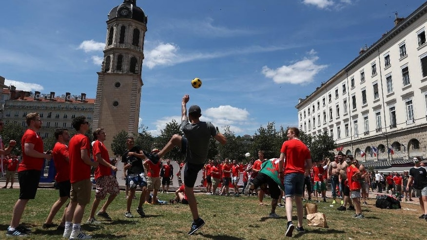 Wales fans play with a ball in central Lyon, France, Wednesday, July 6, 2016, prior the Euro 2016 semifinal soccer match between Portugal and Wales. (AP Photo/Thanassis Stavrakis)
