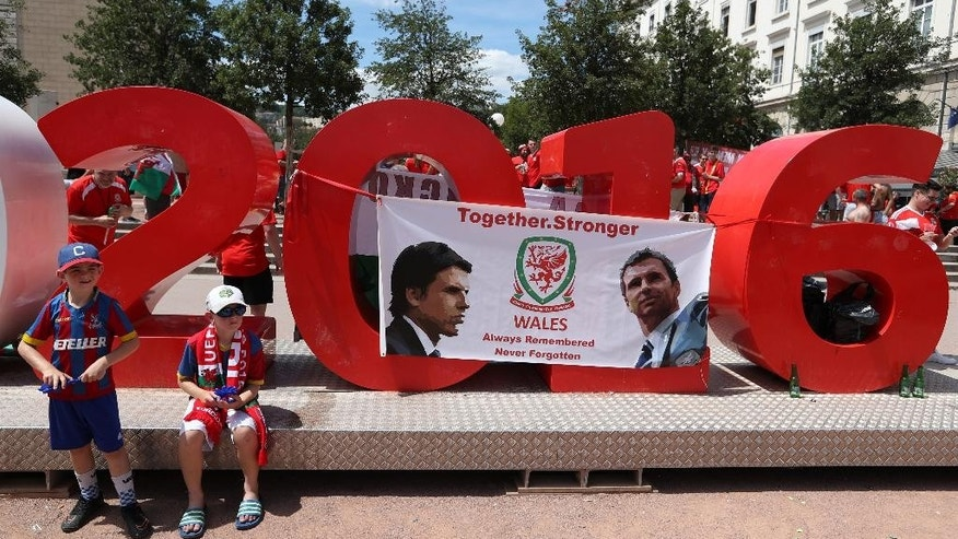 Wales fans gather in central Lyon, France, Wednesday, July 6, 2016, prior the Euro 2016 semifinal soccer match between Portugal and Wales. (AP Photo/Thanassis Stavrakis)