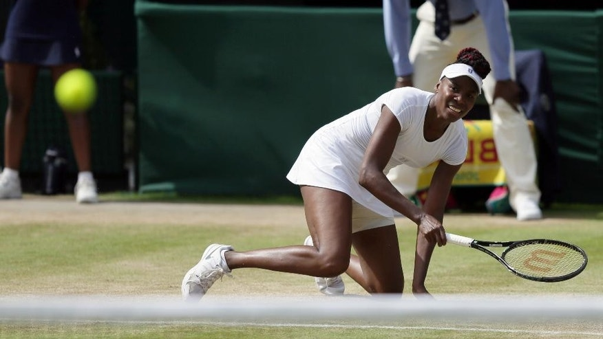 Venus Williams of the U.S returns to Angelique Kerber of Germany during their women's singles match on day eleven of the Wimbledon Tennis Championships in London, Thursday, July 7, 2016. (AP Photo/Tim Ireland)