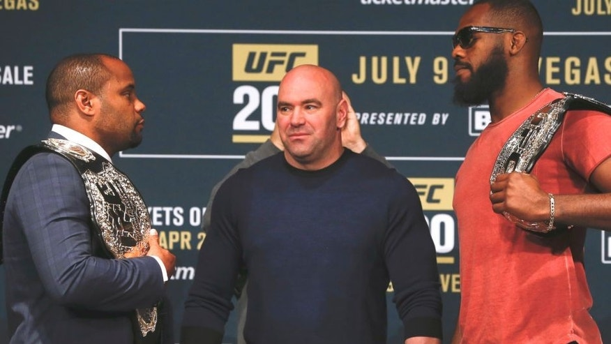 NEW YORK, NY - APRIL 27: UFC president Dana White stars between Daniel Cormier (L) and Jon Jones as they square off during a media availability for UFC 200 at Madison Square Garden on April 27, 2016 in New York City. (Photo by Jeff Zelevansky/Getty Images)