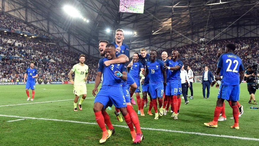 France players celebrate with the supporters at the end of the Euro 2016 semifinal soccer match between Germany and France, at the Velodrome stadium in Marseille, France, Thursday, July 7, 2016. (AP Photo/Martin Meissner)