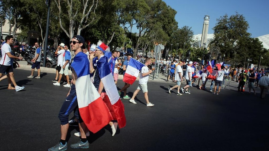France supporters walk, near the Velodrome stadium in Marseille, prior to the Euro 2016 semifinal soccer match between France and Germany, Thursday, July 7, 2016. (AP Photo/Thibault Camus)