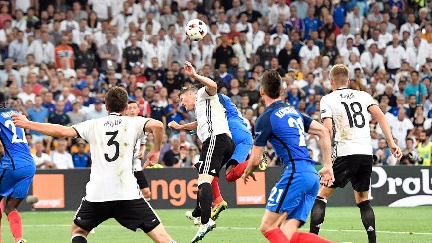 Germany's Bastian Schweinsteiger, center left, jumps for the ball with France's Patrice Evra and handles the ball during the Euro 2016 semifinal soccer match between Germany and France, at the Velodrome stadium in Marseille, France, Thursday, July 7, 2016. (AP Photo/Martin Meissner)