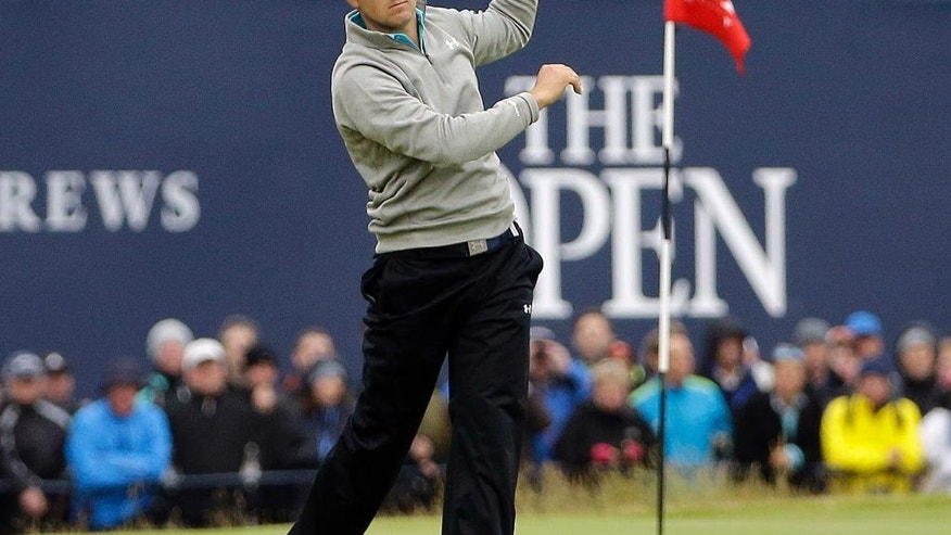 FILE - In this July 20, 2015, file photo, United States' Jordan Spieth makes a wayward drive from the 18th tee during the final round at the British Open Golf Championship at the Old Course, St. Andrews, Scotland.  The Open is scheduled for July 14–17, 2016, at Royal Troon Golf Club in Ayrshire, Scotland. (AP Photo/David J. Phillip, File)