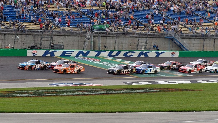 Competitors start the NASCAR Xfinity Series auto race at Kentucky Speedway, Friday, July 8, 2016, in Sparta, Ky. (AP Photo/Timothy D. Easley)