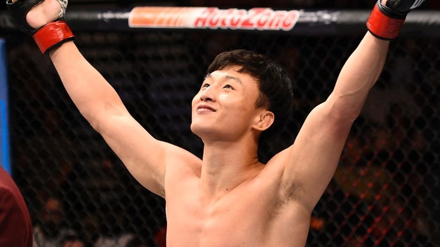 LAS VEGAS, NV - JULY 08: Doo Ho Choi of South Korea celebrates after his knockout victory over Thiago Tavares of Brazil in their featherweight bout during The Ultimate Fighter Finale event at MGM Grand Garden Arena on July 8, 2016 in Las Vegas, Nevada. (Photo by Jeff Bottari/Zuffa LLC/Zuffa LLC via Getty Images)