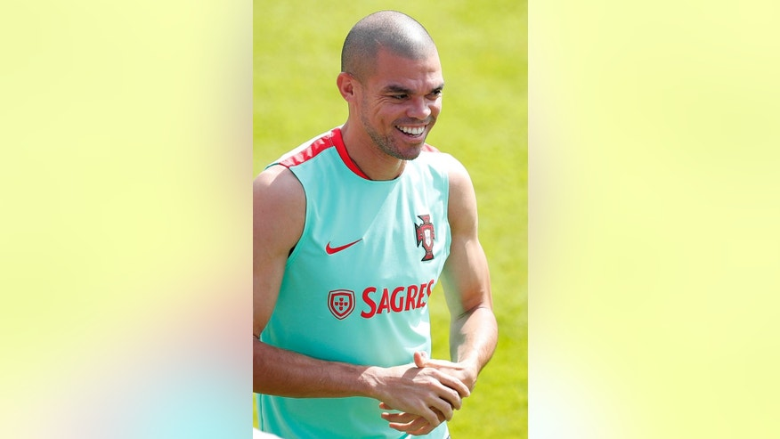 Portugal's Pepe arrives for a training session, in preparation of the Euro 2016 final soccer match between France and Portugal, at Marcoussis, south of Paris, France, Friday, July 8, 2016. (AP Photo/Francois Mori)