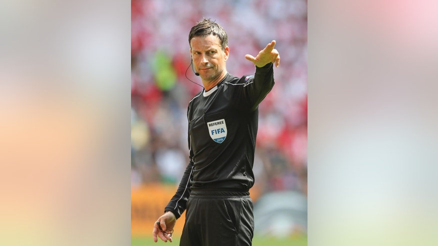 FILE - In this Saturday, June 25, 2016 file photo, referee Mark Clattenburg directs the Euro 2016 round of 16 soccer match between Switzerland and Poland, at the Geoffroy Guichard stadium in Saint-Etienne, France. English official Mark Clattenburg will referee the Euro 2016 soccer final between France and Portugal scheduled for Sunday, July 10, 2016 at the Stade de France in Saint-Denis, north of Paris. (AP Photo/Thanassis Stavrakis, File)