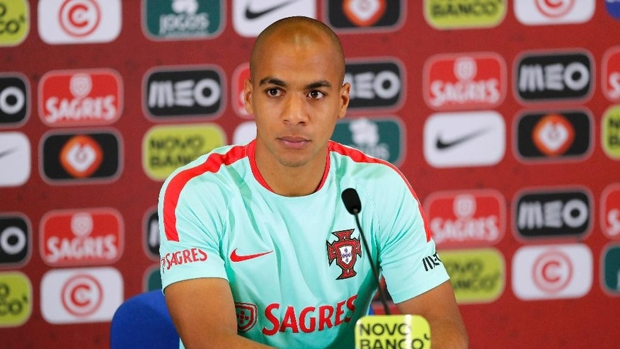 Portugal's Joao Mario ponders a question during a press conference, in preparation of the Euro 2016 final soccer match between France and Portugal, at Marcoussis, south of Paris, France, Friday, July 8, 2016. (AP Photo/Francois Mori)