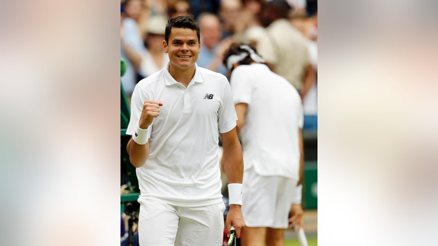 Milos Raonic of Canada celebrates after beating Roger Federer of Switzerland in their men's semifinal singles match on day twelve of the Wimbledon Tennis Championships in London, Friday, July 8, 2016. (AP Photo/Alastair Grant)