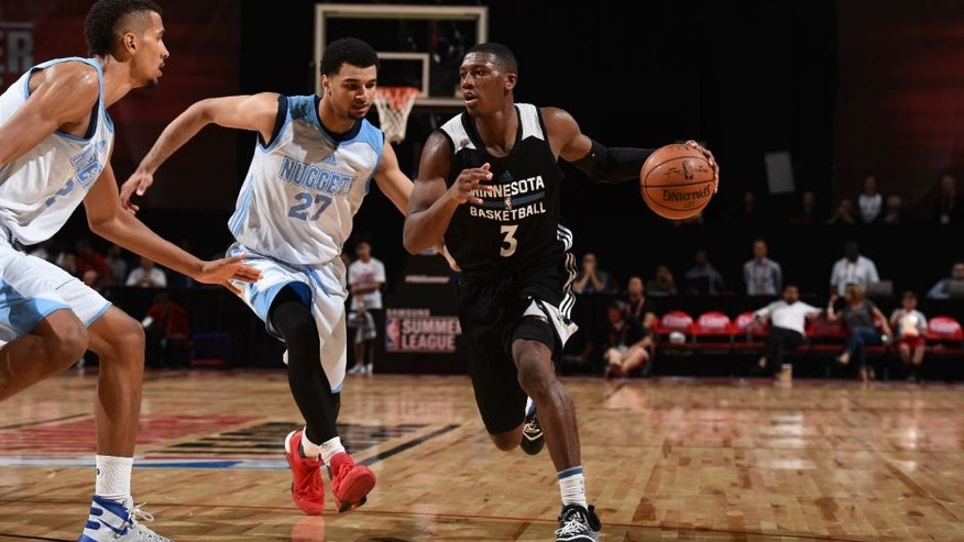 Kris Dunn of the Minnesota Timberwolves drives to the basket against the Denver Nuggets during the 2016 Las Vegas Summer League.