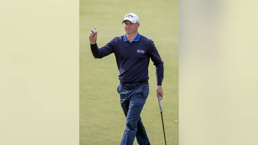 Sweden's Alex Noren acknowledges the fans after his birdie on the 8th hole gave him the outright lead, during day two of the 2016 AAM Scottish Open at Castle Stuart Golf Links, Inverness, Scotland, Friday July 8, 2016. (Kenny Smith / PA via AP)