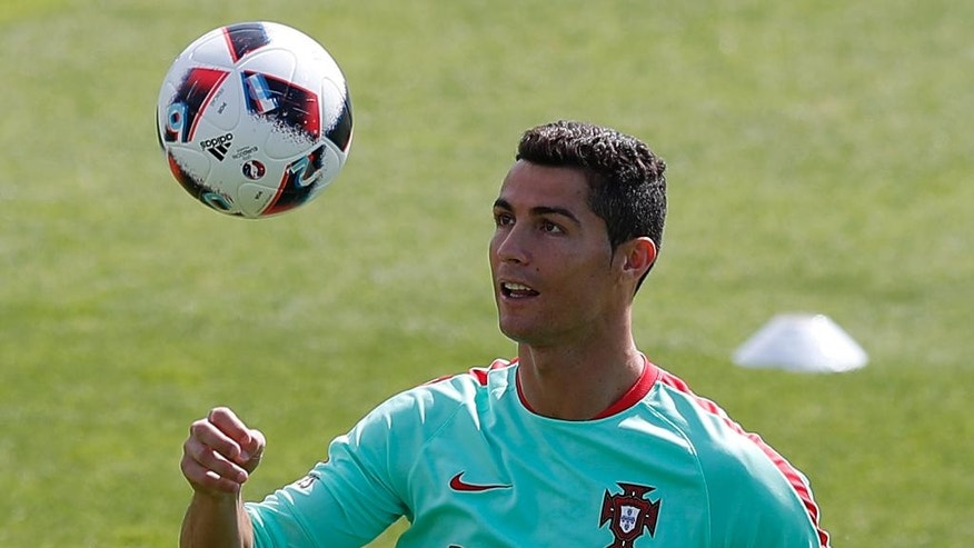 Portugal's Cristiano Ronaldo controls the ball during a training session, in preparation of the Euro 2016 final soccer match between France and Portugal, at Marcoussis, south of Paris, France, Friday, July 8, 2016. (AP Photo/Francois Mori)