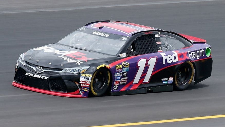 SPARTA, KY - JULY 07: Denny Hamlin, driver of the #11 FedEx Freight Toyota, practices for the NASCAR Sprint Cup Series Quaker State 400 at Kentucky Speedway on July 7, 2016 in Sparta, Kentucky. (Photo by Brian Lawdermilk/NASCAR via Getty Images)