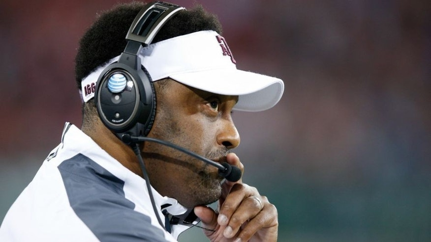 NASHVILLE, TN - DECEMBER 30: Head coach Kevin Sumlin of the Texas A&M Aggies looks on against the Louisville Cardinals during the Franklin American Mortgage Music City Bowl at Nissan Stadium on December 30, 2015 in Nashville, Tennessee. Louisville defeated Texas A&M 27-21. (Photo by Joe Robbins/Getty Images)