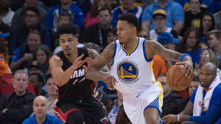 January 11, 2016; Oakland, CA, USA; Golden State Warriors forward Brandon Rush (4) dribbles the basketball against Miami Heat forward Gerald Green (14) during the second quarter at Oracle Arena. The Warriors defeated the Heat 111-103. Mandatory Credit: Kyle Terada-USA TODAY Sports