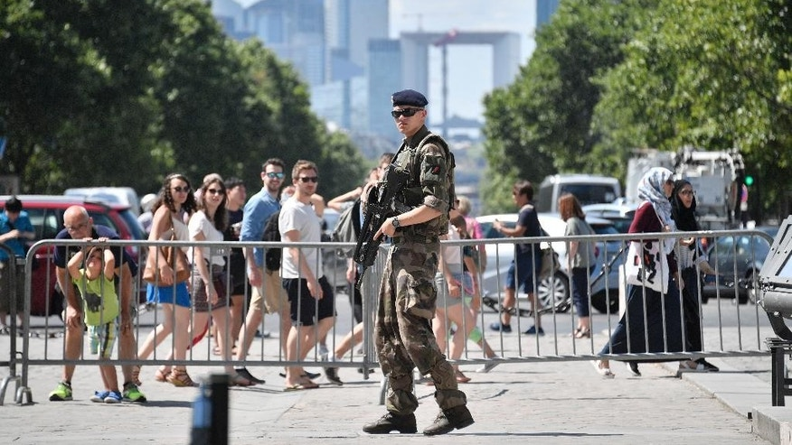 A French soldier patrols in the streets of Paris Saturday July 9, 2016. French police and troops are gearing up for their biggest security challenge since the deadly Nov. 13 attacks across Paris last year, as hundreds of thousands of fans mass in the French capital for Sunday's Euro 2016 European Soccer Championship final. (AP Photo/Martin Meissner)