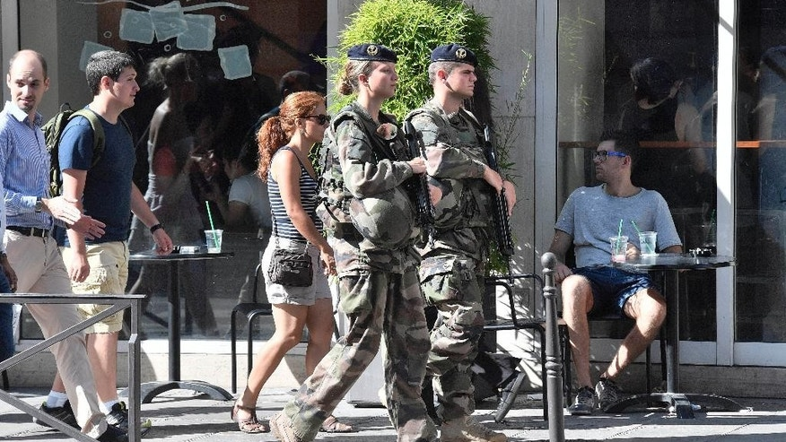 French soldiers patrol in the streets of Paris Saturday July 9, 2016. French police and troops are gearing up for their biggest security challenge since the deadly Nov. 13 attacks across Paris last year, as hundreds of thousands of fans mass in the French capital for Sunday's Euro 2016 European Soccer Championship final. (AP Photo/Martin Meissner)