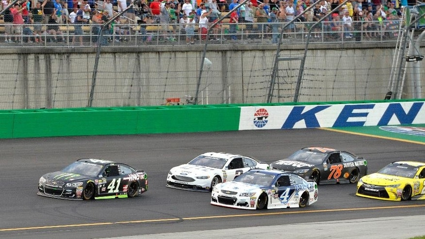 Kurt Busch (41) leads the field following a restart during the NASCAR Sprint Cup Series auto race at Kentucky Speedway, Saturday, July 9, 2016 in Sparta, Ky. (AP Photo/Timothy D. Easley)