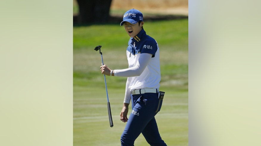 Sung Hyun Park, of South Korea, reacts after missing a birdie putt on the second green during the third round of the U.S. Women's Open golf tournament at CordeValle Saturday, July 9, 2016, in San Martin, Calif. (AP Photo/Eric Risberg)