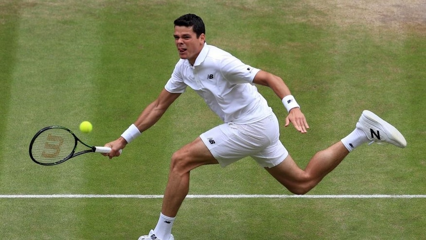 Milos Raonic of Canada returns to Roger Federer of Switzerland during their men's semifinal singles match on day twelve of the Wimbledon Tennis Championships in London, Friday, July 8, 2016. (Adam Davy/Pool Photo via AP)