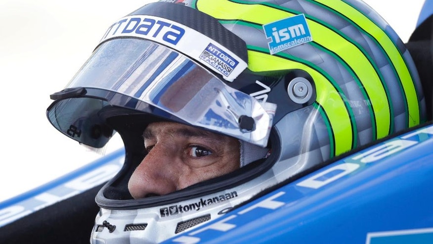 Tony Kanaan sits in his car during practice for the IndyCar Series auto race Saturday, July 9, 2016, at Iowa Speedway in Newton, Iowa. (AP Photo/Charlie Neibergall)