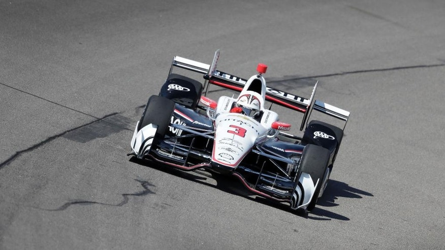 Helio Castroneves drives his car during practice for the IndyCar Series auto race Saturday, July 9, 2016, at Iowa Speedway in Newton, Iowa. (AP Photo/Charlie Neibergall)
