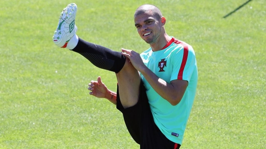Portugal's Pepe stretches during a training session in Marcoussis, near Paris, France, Saturday, July 9, 2016. Portugal will face France in a Euro 2016 final soccer match in Saint Denis on Sunday, July 10, 2016. (AP Photo/Thibault Camus)