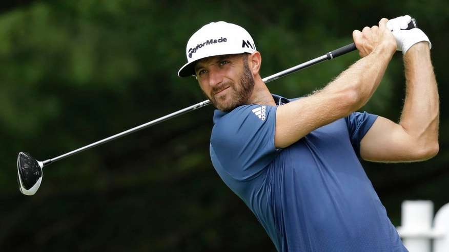 July 3, 2016: Dustin Johnson tees off on the second hole during the final round of the Bridgestone Invitational golf tournament at Firestone Country Club in Akron, Ohio.