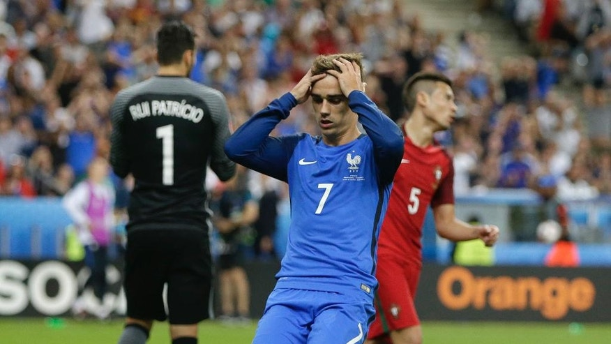 France's Antoine Griezmann reacts after missing an opportunity to score during the Euro 2016 final soccer match between Portugal and France at the Stade de France in Saint-Denis, north of Paris, Sunday, July 10, 2016. (AP Photo/Thanassis Stavrakis)