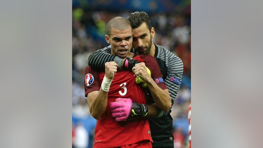 Portugal goalkeeper Rui Patricio, right, celebrates with Pepe winning the Euro 2016 final soccer match between Portugal and France at the Stade de France in Saint-Denis, north of Paris, Sunday, July 10, 2016. (AP Photo/Thanassis Stavrakis)