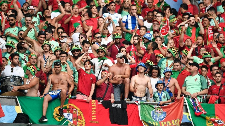 Portugal supporters on the stands wait for the start of the Euro 2016 final soccer match between Portugal and France at the Stade de France in Saint-Denis, north of Paris, Sunday, July 10, 2016. (AP Photo/Martin Meissner)