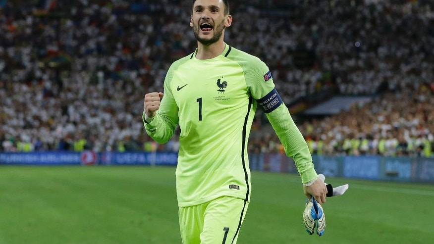 France goalkeeper Hugo Lloris celebrates after the Euro 2016 semifinal soccer match between Germany and France, at the Velodrome stadium in Marseille, France, Thursday, July 7, 2016. (AP Photo/Thanassis Stavrakis)