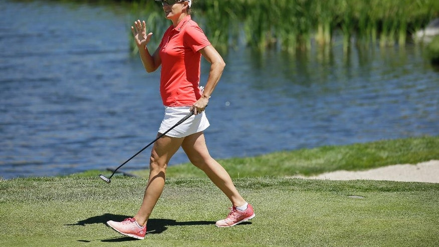 Brittany Lang waves to the gallery while walking to the fifth green during the final round of the U.S. Women's Open golf tournament at CordeValle, Sunday, July 10, 2016, in San Martin, Calif. (AP Photo/Eric Risberg)